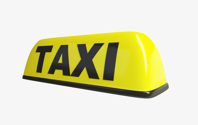 Small yellow taxi sign often displayed atop taxicabs world wide to make the cabs stand out from other cars.